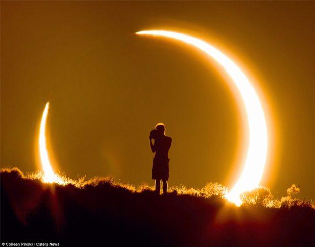 Impresionante instantánea de un niño viendo un eclipse siendo fotografiado a 2.3 km de distancia